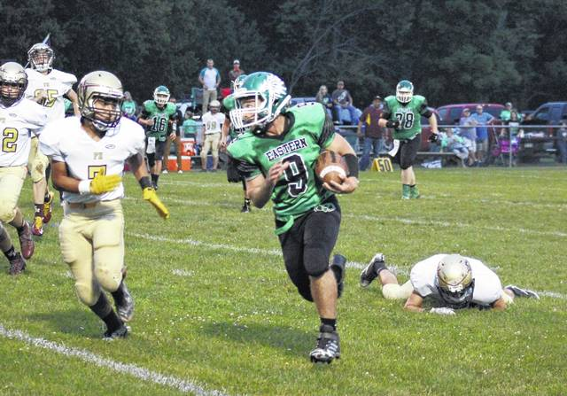 Eastern senior Josh Brewer breaks a long run during the Eagles' 35-14 victory over Federal Hocking on Friday night in Tuppers Plains, Ohio.