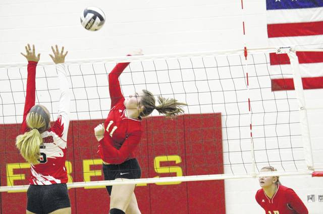 South Gallia's Erin Evans (11) goes up for a kill attempt over Wahama's Gracie VanMeter (5) during Tuesday night's Tri-Valley Conference Hocking Division volleyball match in Mercerville, Ohio.