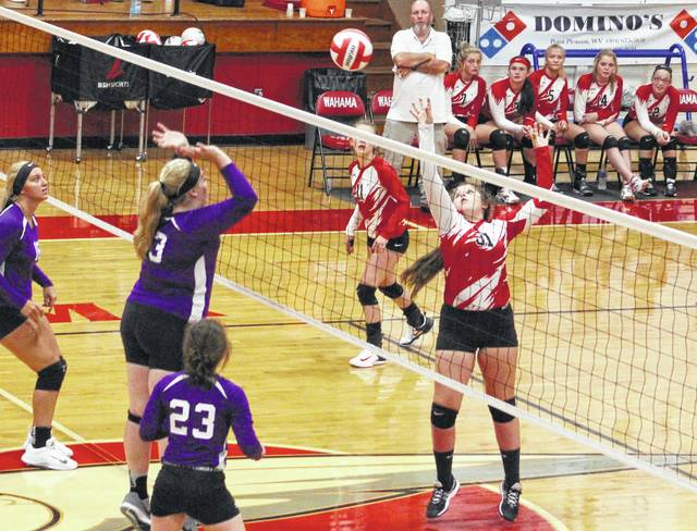 Wahama junior Alexis Mick (31) hits a ball over the net during Game 1 of Wednesday night's TVC Hocking volleyball contest against Miller at Gary Clark Court in Mason, W.Va.