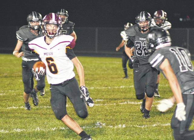 Meigs sophomore Weston Baer (6) tries to elude River Valley defender Dustin Barber (10) during a Week 5 TVC Ohio football contest held Friday night in Bidwell, Ohio.