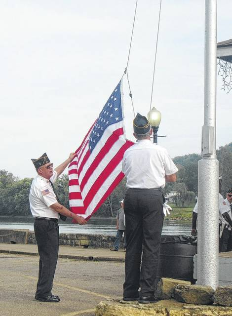 Members of the American Legion prepare for the National Anthem and flag raising during the Sternwheel Regatta opening ceremony on Friday evening.