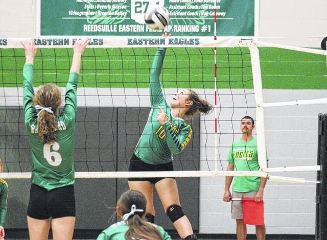 Eastern junior Kelsey Casto (10) goes up for a spike over Waterford's Allex Teters (6) during the Lady Wildcats' win on Monday in Tuppers Plains, Ohio.
