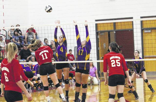 Southern's Marissa Brooker (4) and Abby Cummins (17) go up for a block attempt over South Gallia's Erin Evans (11) during Monday night's Tri-Valley Conference Hocking Division volleyball match in Mercerville, Ohio.