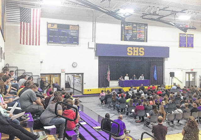 A view from the bleachers in the Southern High School gymnasium shows the Meigs County Commissioners seated on the stage as Southern students look on during Thursday's meeting.