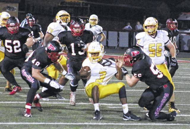 Point Pleasant defender Eddie Mayes, right, brings down a Mount View ball carrier as teammates Cameron Nott (48) closes in during the first quarter of Friday night's Week 5 Homecoming contest at OVB Field in Point Pleasant, W.Va.