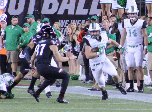 Marshall redshirt freshman Cody Mitchell returns a kickoff during the third quarter of Saturday night's non-conference football game against Cincinnati at Nippert Stadium in Cincinnati, Ohio.