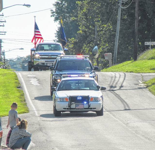 The Racine Police Department leads the Party in the Park parade down Elm Street on Saturday morning, followed by the Meigs County Sheriff's Office and Racine American Legion.