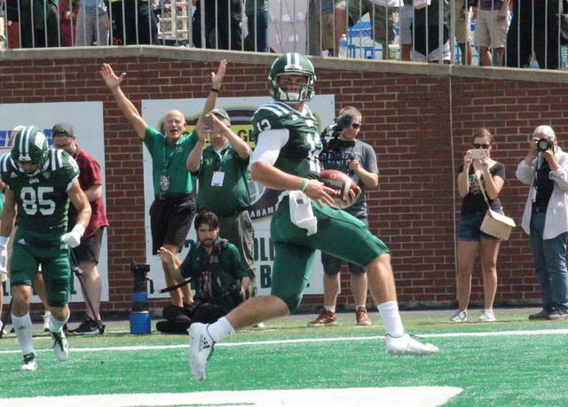 Ohio's Nathan Rourke (12) scores a rushing touchdown during the Bobcats' win over Kansas on Sept. 16 in Athens, Ohio. (Alex Hawley|OVP Sports)