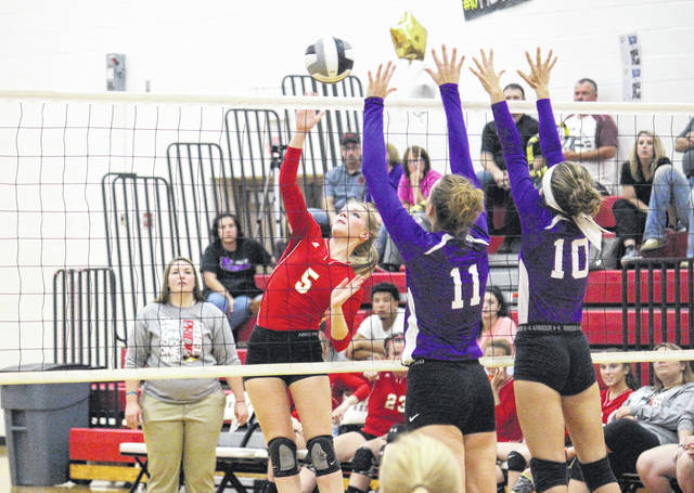 South Gallia senior Olivia Hornsby (5) goes up for a kill attempt over Miller's Brooklyn Wilson (10) and Olivia Houk (11) during Monday night's Tri-Valley Conference Hocking Division volleyball match in Mercerville, Ohio.