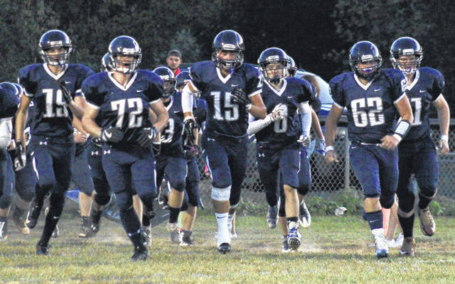 The Wildcats are led onto the field by seniors Alex Lemieux (19), Riley Griffith (72), Logan Nibert (15) Tyler Cochran (8), Nathan McQueen (62) and James Edmonds (right), before the Wildcats' victory over Jenkins on Sept. 29 in Ashton, W.Va.