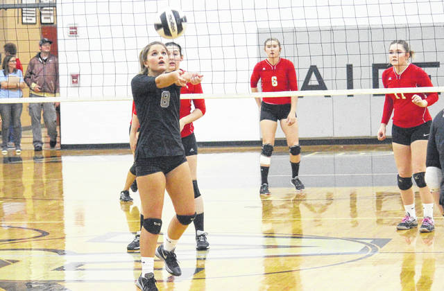 River Valley's Jessica Roush (8) hits a free ball as South Gallia's Christine Griffith (25), Rachal Colburn (6) and Erin Evans await the return during Wednesday night's non-league volleyball match in Bidwell, Ohio.
