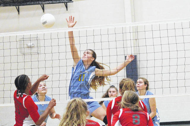 Ohio Valley Christian School's Laura Young (11) goes up for a kill attempt during the Lady Defenders' volleyball match against Point Pleasant on Thursday in Gallipolis, Ohio.