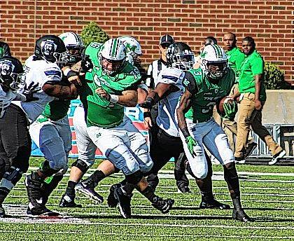 Marshall running back Tyler King, right, breaks away for a big gain during an Oct. 14 Conference USA football game against Charlotte at Joan C. Edwards Stadium in Huntington, W.Va.