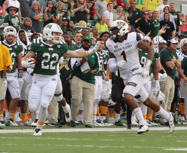 Ohio running back David Burroughs (22) delivers a stiff arm to a Kent State defender during a third quarter run Saturday in a Mid-American Conference football game in Athens, Ohio. (Bryan Walters|OVP Sports)