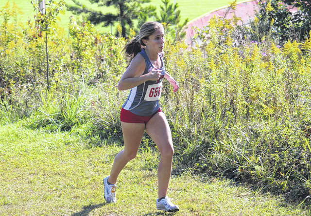 Point Pleasant junior Allison Henderson competes in the girls high school race as part of the Patty Forgey Invitational cross country meet on Sept. 23 in Rio Grande, Ohio.