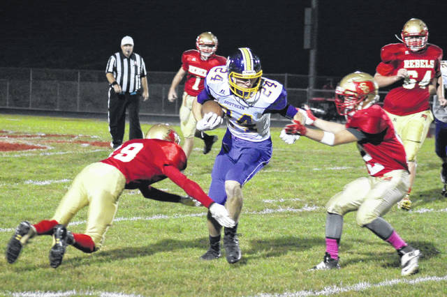 Southern senior Garrett Wolfe (24) fends off Rebels Austin Stapleton (left) and Jacob Birtcher (right), during the Tornadoes' 48-0 victory on Friday in Mercerville, Ohio.