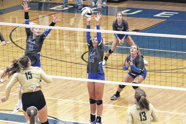 Gallia Academy junior Hunter Copley (14) blocks an AHS spike attempt in front of teammates Ashton Webb (11), Alex Barnes (back) and Ryelee Sipple (right), during the Blue Angels' 3-1 victory in the sectional final on Saturday in Centenary, Ohio.