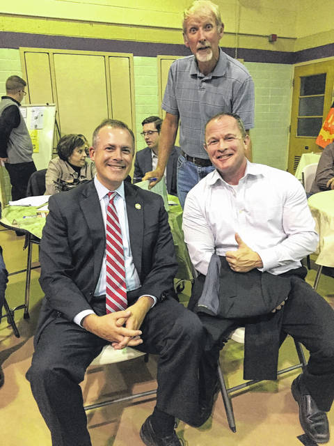 State Rep. Robert Sprague, Board of Elections member Jimmy Stewart and Commissioner Tim Ihle are pictured at the annual Republican Bean Dinner where Ihle announced his re-election bid.