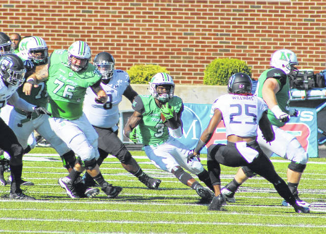 Marshall running back Tyler King (3) makes a cut-back move during a second quarter run against Old Dominion during a Conference USA football game on Saturday, Oct. 15, at Joan C. Edwards Stadium in Huntington, W.Va.