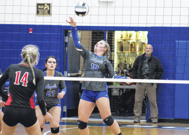 Gallia Academy freshman Ryelee Sipple (10) attempts a spike in front of junior teammate Taylor Burnette (21), during the Blue Angels' 3-1 district semifinal loss to Logan Elm on Wednesday in Londonderry, Ohio.