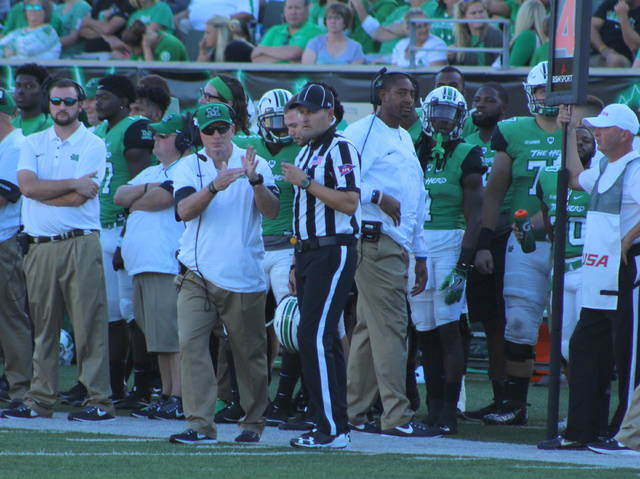 Marshall football coach Doc Holliday signals for a timeout during an Oct. 14 football contest against Old Dominion at Joan C. Edwards Stadium in Huntington, W.Va.
