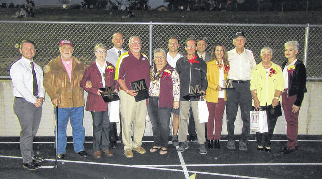 The 2017 Distinguished Alumni and Distinguished Service award recipients are pictured along with members of their families and presenters. Award recipients were Jennifer Sheets, Tom Reed, Michael Bartrum and John Tannehill.