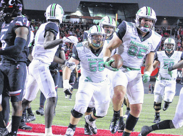 Marshall tight end Ryan Yurachek (85) celebrates after scoring his second of three touchdowns Saturday night during a 38-21 victory over Cincinnati in a non-conference contest at Nippert Stadium in Cincinnati, Ohio.