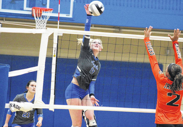 Gallia Academy junior Ashton Webb (11) spikes the ball in front of teammate Taylor Burnette (21), during the Blue Angels' 3-1 win on Thursday in Centenary, Ohio.
