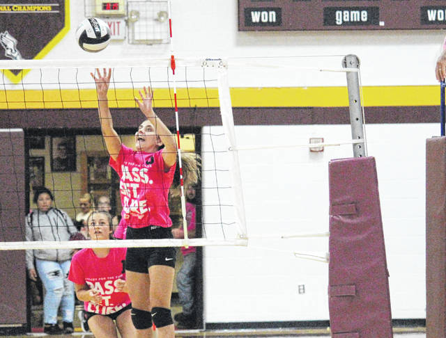 Meigs' Marissa Noble (8) goes up for a kill attempt during the Lady Marauders' Tri-Valley Conference Ohio Division volleyball match against River Valley on Thursday night in Rocksprings, Ohio.