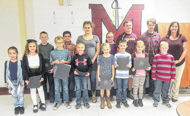 The Meigs Local Board of Education recognized several students of the month during its recent meeting. Board member Heather Hawley is pictured with the students who were in attendance. A complete list of the student honorees appears in the article.