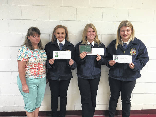 Southern High School FFA students Caelin Seth, Kristen McKay, and Ciera Whitesell were recognized as first, second and third place participants in the Agricultural Land Judging Competition held in September near New Marshfield. The top scoring team was from Southern and included Seth, McKay, Whitesell, and Riley Holding. Shown are, from left: Meigs SWCD education coordinator Jenny Ridenour, Whitesell, McKay, and Seth.