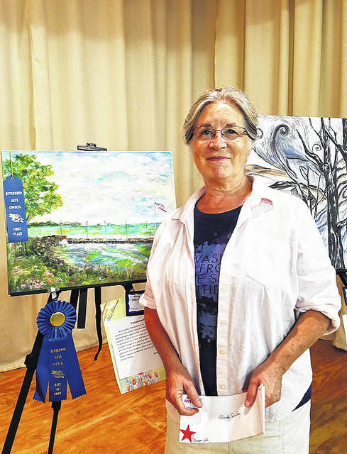Becky DeLong received Best of Show during Saturday's Art in the Village hosted by the Riverbend Arts Council.