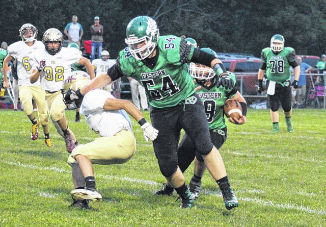 Eastern senior Wyatt Bissell (54) blocks for classmate Josh Brewer (9) during the Eagles' win over Federal Hocking on Sept. 15 in Tuppers Plains, Ohio.