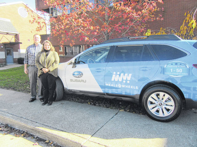 John Matson and Beth Shaver from the Meigs County Council on Aging are pictured with the 2018 Subaru Outback which was awarded to the agency by Subaru.