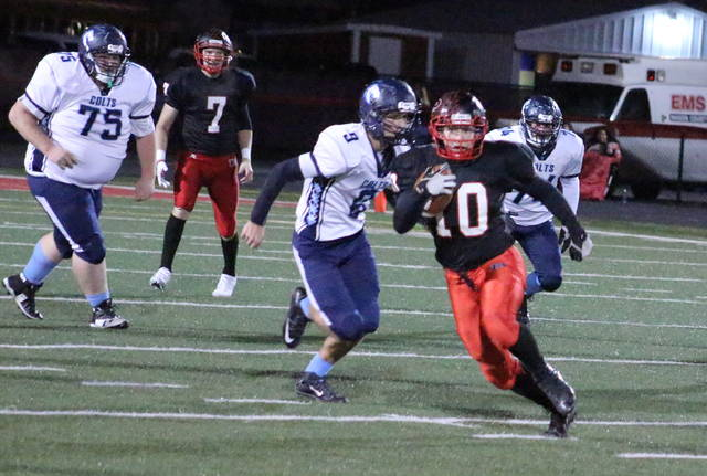 Point Pleasant running back Justin Brumfield (10) runs away from the Philip Barbour defense during the first half of Saturday night's Class AA opening round playoff game at OVB Field in Point Pleasant, W.Va.
