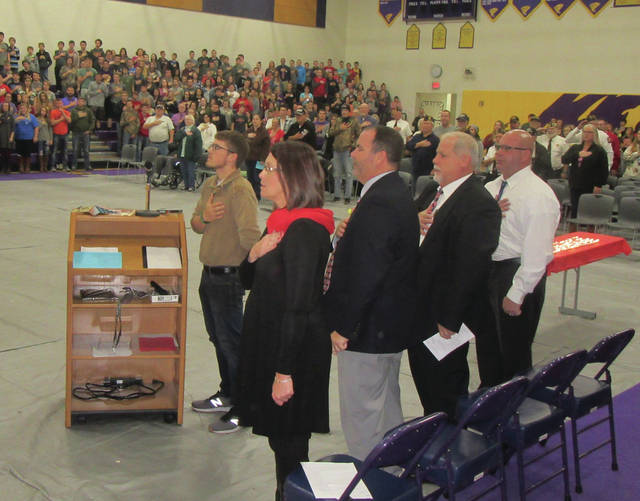 Southern High School Student Council President Connor Thomas, nearest to the podium, leads the Pledge of Allegiance during Friday's Veterans Day Program in the Southern High School Gymnasium. Also pictured, from left, are Speaker Missy Hoback, Supt. Tony Deem, Scott Wolfe and Ed Baker.