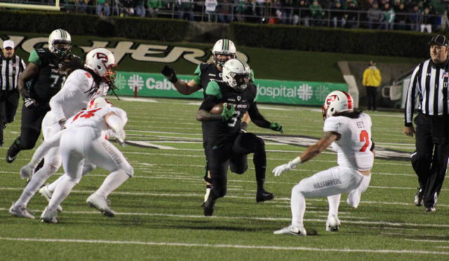 Marshall freshman Tyler King (3) makes a move between a trio of Hilltoppers, during the Thundering Herd's 30-23 victory on Saturday in Huntington, W.Va. (Alex Hawley|OVP Sports)