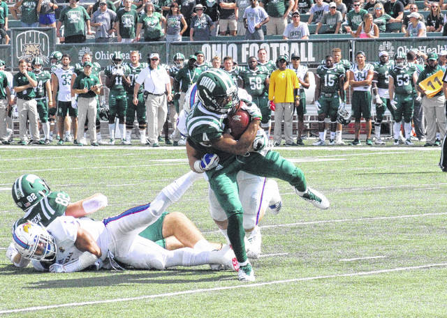 Ohio's Papi White (4) holds on to the ball for a reception, during the Bobcats' victory over Kansas on Sept. 16 in Athens, Ohio.