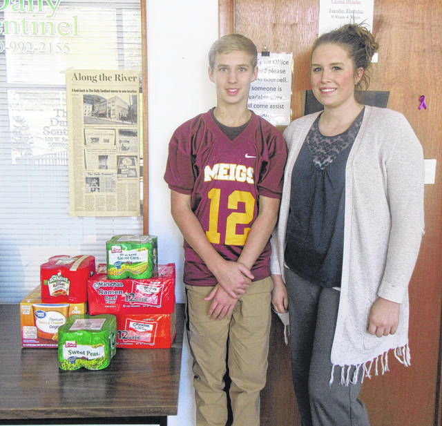 Payton VanInwagen and his step-mom Heather Brooks are collecting non-perishable food items to be donated to the Meigs Veterans Outreach in Pomeroy.