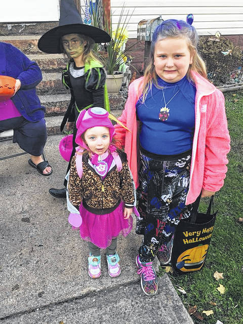 Courtlynn and Franki Krautter go trick or treating in Middleport.
