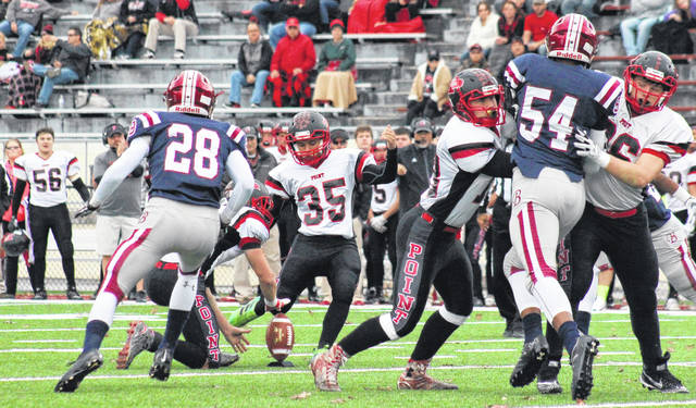 Point Pleasant senior Jacob Bryant (35) kicks in a field goal, during the first half of the Big Blacks' 49-17 loss in the Class AA quarterfinal on Saturday in Bluefield, W.Va.