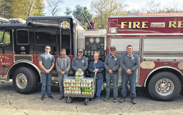 Hilda Weaver accepts the food and cash donations on behalf of the Meigs Cooperative Parish. Pictured with Weaver are Firemen's Association members Tyler Peyton, Willie Zahran, Richard Peyton, Aaron Oliphant, and Derek Miller.