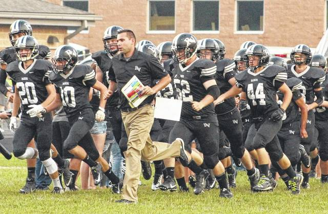 River Valley football coach Jerrod Sparling takes the field alongside his players moments before a 2015 Week 2 football contest against Gallia Academy in Bidwell, Ohio.