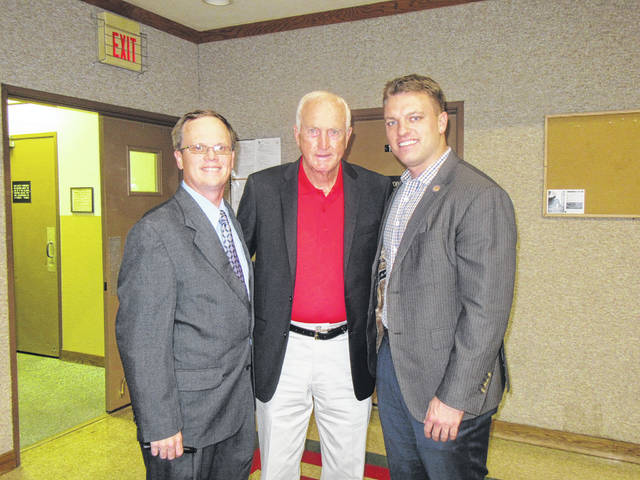 Former Ohio State University football coach John Cooper took time for photos and autographs before Thursday evening's Meigs County Chamber of Commerce Gala where he served as the keynote speaker. Cooper, center, is pictured with Meigs Chamber of Commerce President John Hoback (left) and State Rep. Jay Edwards (right) before the dinner at the Middleport Church of Christ Family Life Center. Coverage of the Gala, including awards presented, will appear in the Sunday Times-Sentinel.