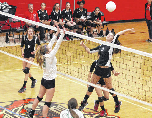 Point Pleasant senior Brenna Dotson (3) leaps for a spike attempt during Game 3 of Wednesday night's Class AA Region IV, Section 1 volleyball match against Winfield in Point Pleasant, W.Va.