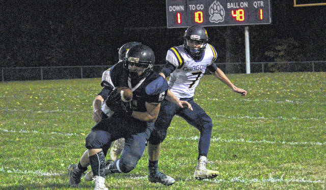 Hannan's Kevin Morehart (6) makes an attempt to catch a pass as Cameron defender Travis Mickey (7) looks on during Friday night's football game in Ashton, W.Va.