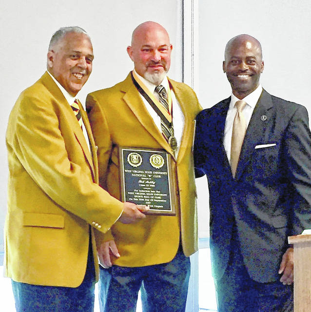 """Middleport native Bob Ashley, center, was recently inducted in the West Virginia State University Hall of Fame. Ashley, a 1982 graduate of Meigs High School, is pictured with William Lipscomb (left), president of the National """"W"""" Club and the Hall of Fame at WVSU. WVSU President, Dr. Anthony L. Jenkins, is also pictured at the right."""