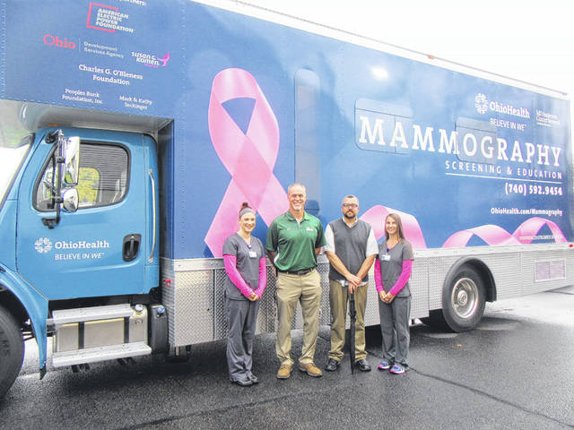 Meigs County Commissioners Mike Bartrum and Randy Smith toured the new mobile mammography unit on Friday. The commissioners are pictured with mammography techs Michelle Lehman and Kelly Jarrett, who drive the unit from location to location and provide screenings on the unit.