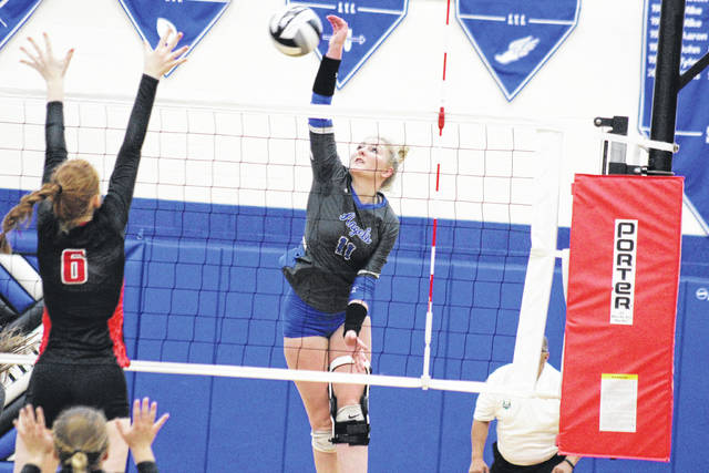 Gallia Academy junior Ashton Webb (11) spikes the ball over a Logan Elm defender during the Division II district semifinal on Oct. 25 in Londonderry, Ohio.