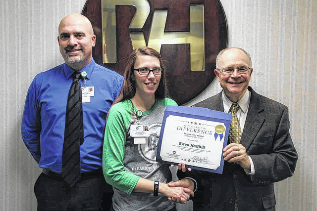 Gwen Halfhill, at center, Pleasant Valley Hospital's Employee of the Month is pictured with John Beaver, pharmacy director, and Glen Washington, FACHE, PVH CEO.